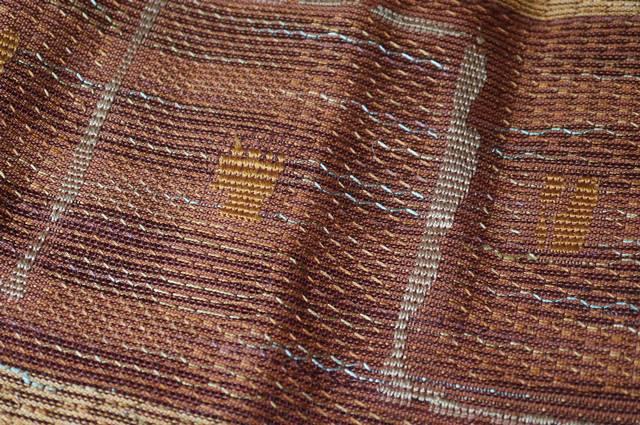 レンガ色の羅の帯
