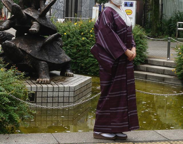 雨コートのシルエット